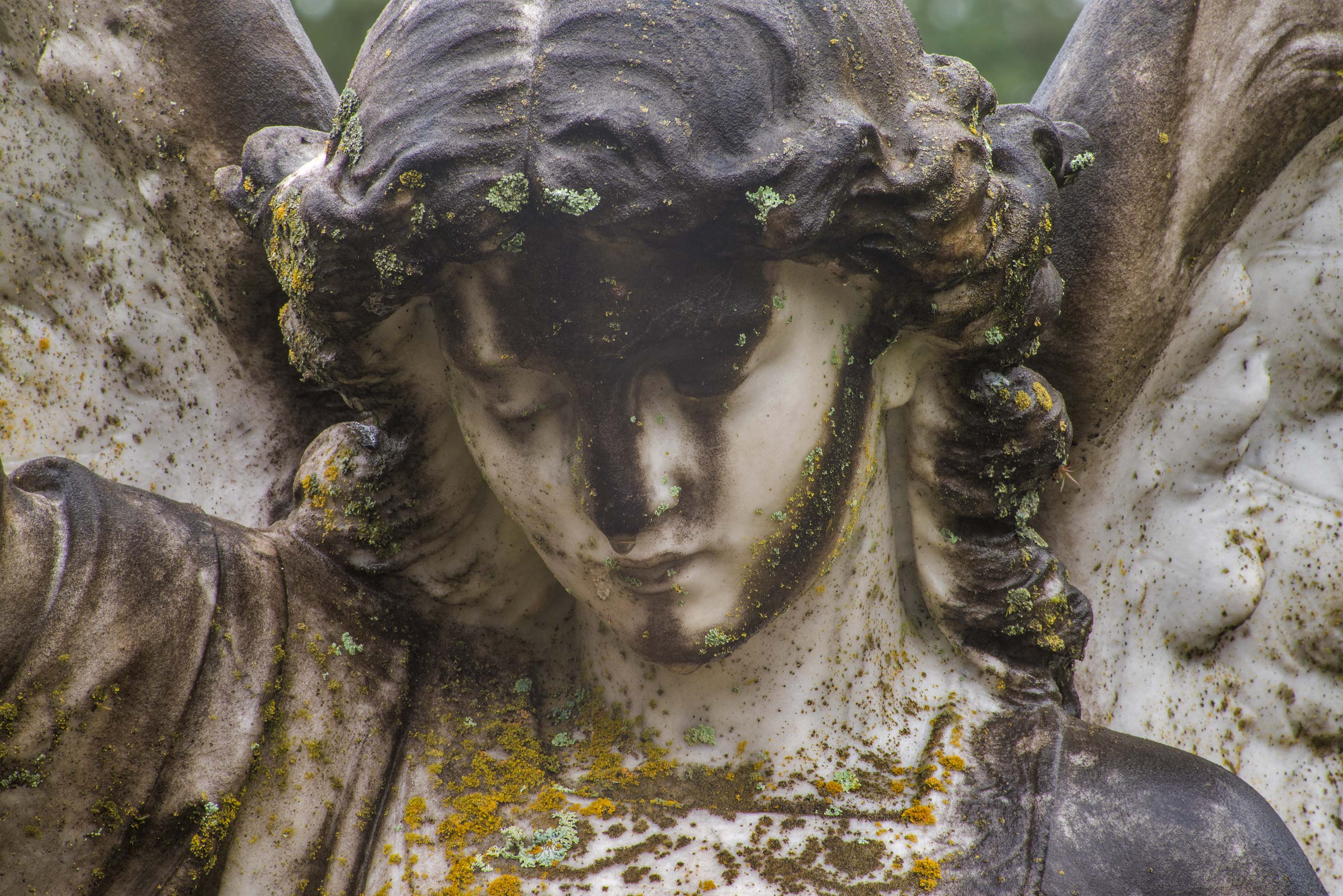 Black-faced marble angel on a tomb of Astin in City Cemetery. Bryan, Texas
