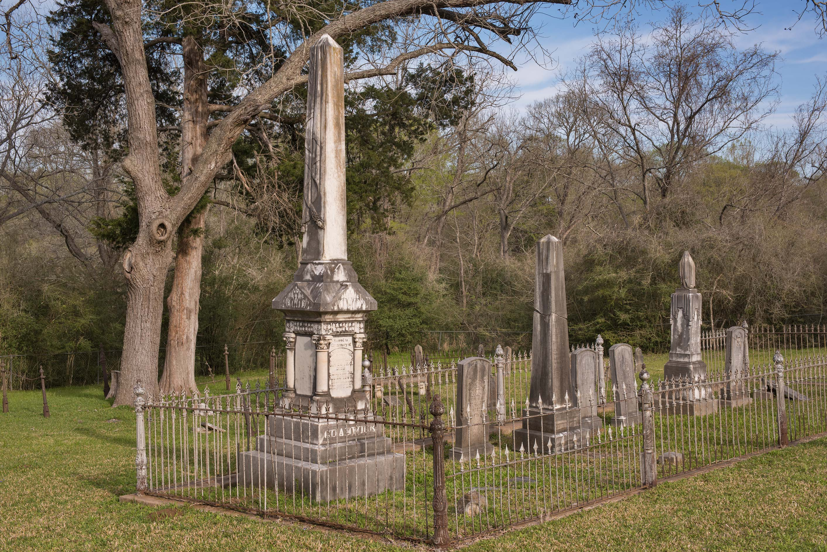 Tall granite tombstones in Masonic Cemetery. Chappell Hill, Texas