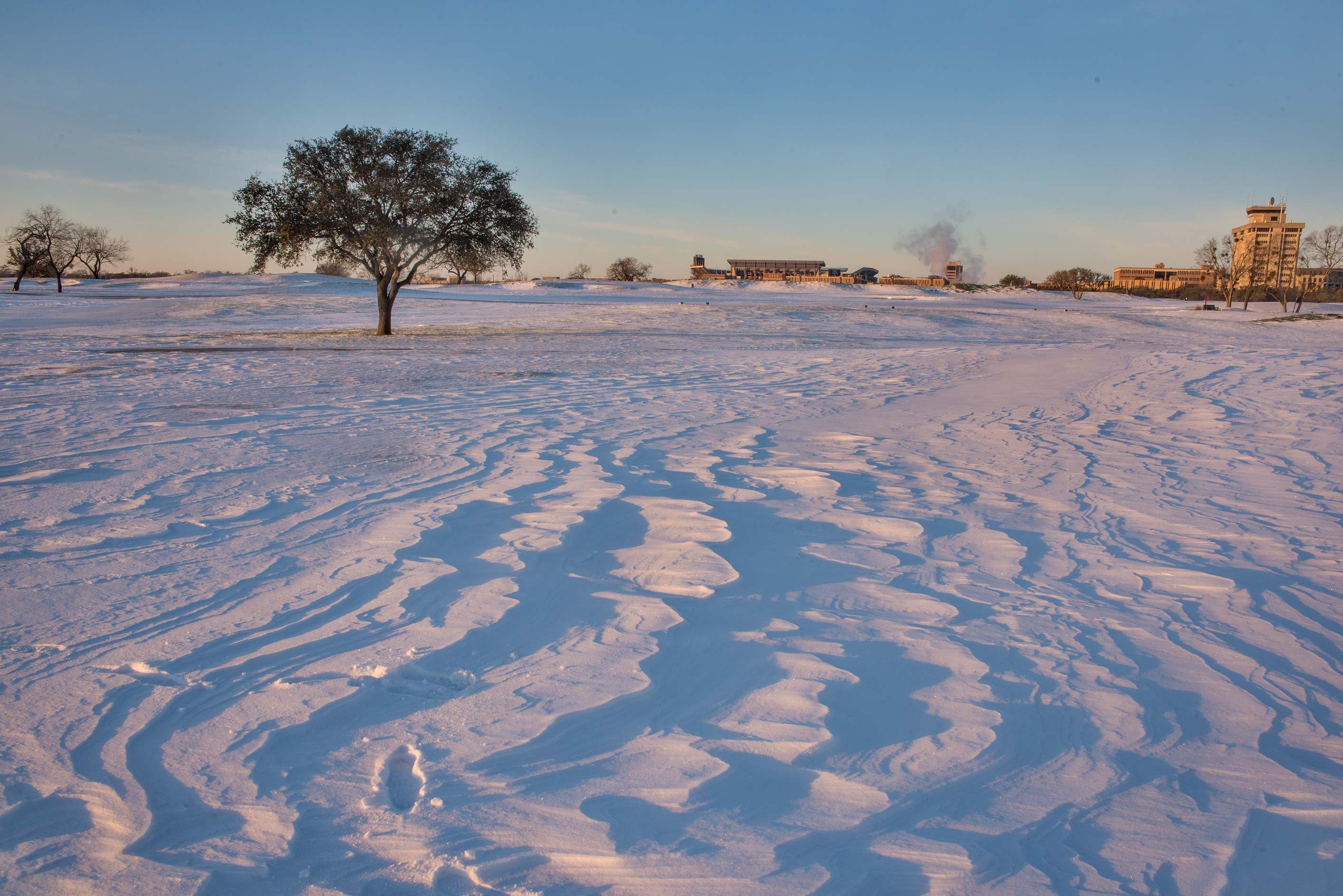 Snow pattern at sunrise on a golf course on...M University. College Station, Texas